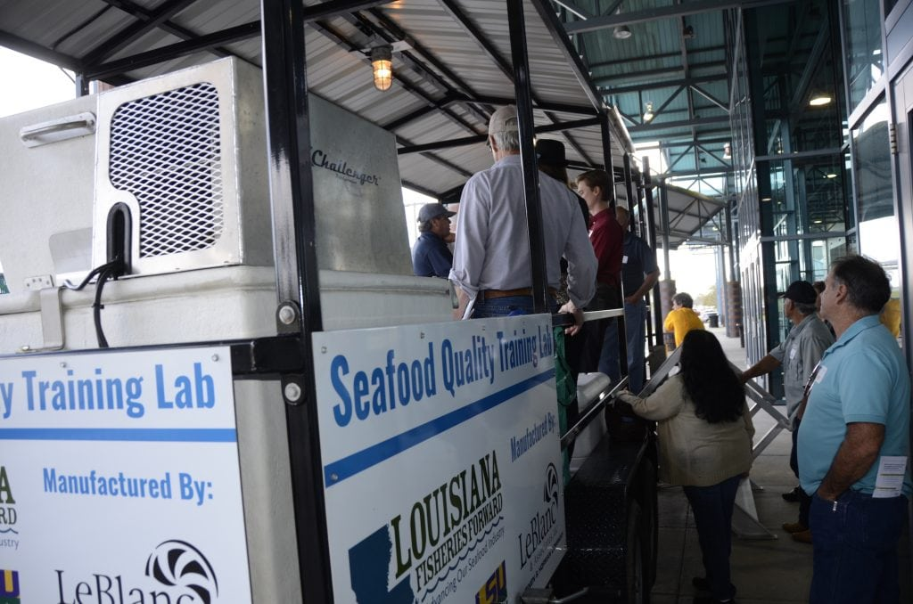 Photo of group learning at the LFF Seafood Quality Training Lab trailer